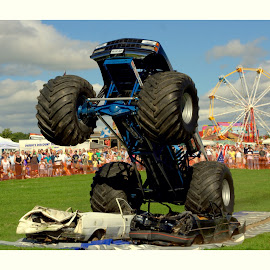 Monster truck in the air by Colin Waite - Transportation Automobiles ( monster truck wheels car flag )