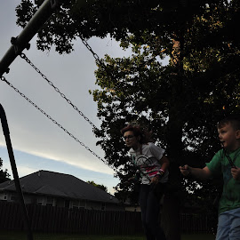 Brother and Sister by Brian Hughes - People Family ( brother & sister, park, swings, summer, siblings )