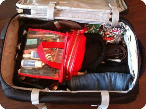 suitcase with items rolled