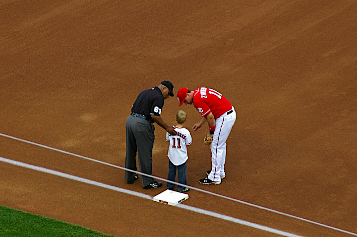 Zimmerman and Umpire talk to starting 9 kid