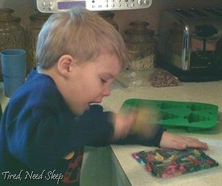 hammering crayons into tiny bits