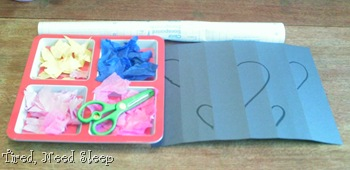supplies - black paper, tissue paper, scissors, contact paper, marker