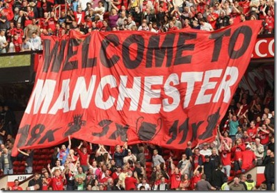 united fans unfurled this flag to show city that the reds still rule in manchester
