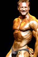 Male Bodybuilders Posing On Stage 3