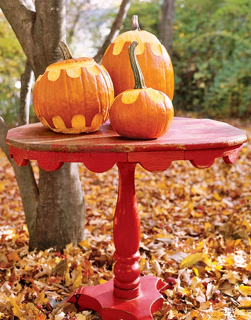 red table and pumpkins