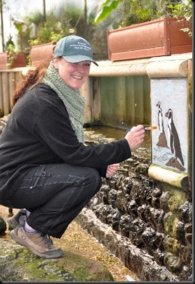 Julie touching up paintings in Tropical House March 11