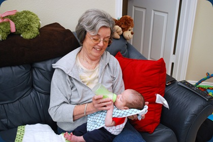 Grandma helping with the feedings