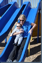 Mom and Landers enjoying the slide