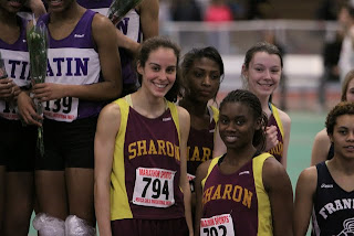 On the podium, the school record setting 4 x 200m relay team (from l to r): Ali Kirsch, Jen Jaboin, Camille Henry, & Sara Gildersleeve