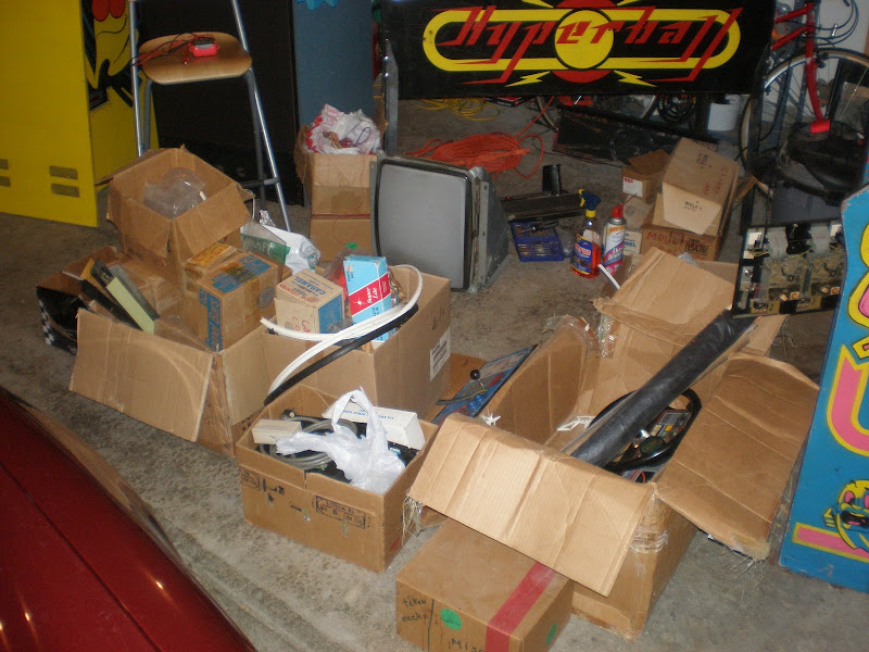 Boxes of arcade game stuff and parts