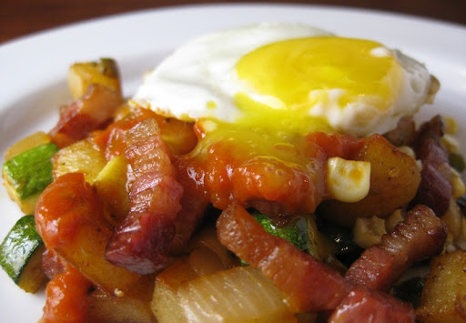 Potato, zucchini and corn hash with pancetta tesa lardons, tomato jam and a fried egg