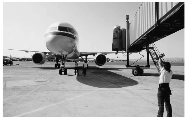Because the sound generated by a jet engine can damage a person's hearing, airport ground crews always wear protective headgear.