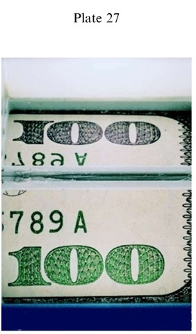 Plate 27 FORGERY AND FRAUD/Counterfeit Currency Green-to-black color shifting link on genuine US banknote. Photographed using an angled mirror: green image (below) at normal; black (above) at an oblique angle.