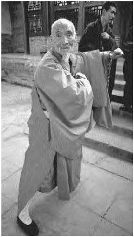 A 74-year-old Buddhist monk practices boxing exercises at a Shaolin monastery near Zengzhou, Henan, China, 1981.