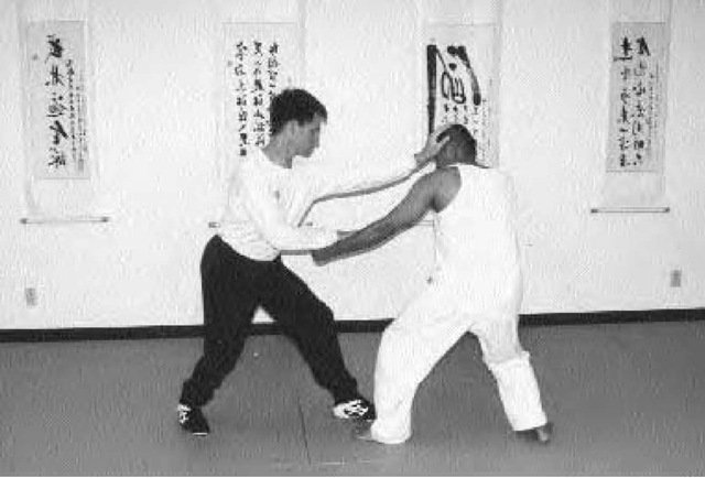 Two students at the Shen Wu Academy of Martial Arts in Garden Grove, California, hone their xingyiquan skills.
