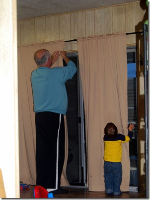putting up curtains