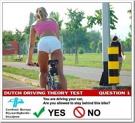 Photo of Hot girl riding a bike in Dutch driving theory test.