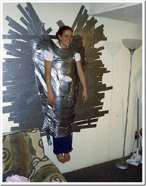 Picture of a girl duct taped to a wall.