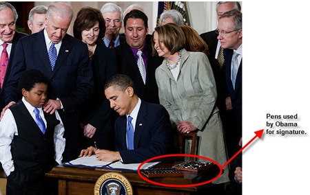 obama signing health care bill