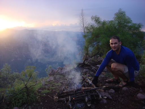 Joshua fireman on peak overlooking Urique Canyon.