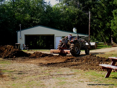 Packing down and leveling the driveway for our departure.