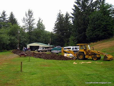 By 7:30 am, the trench had bisected the driveway and was heading up the hill.