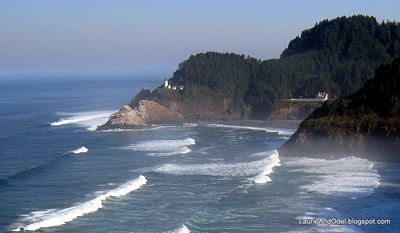 Heceta Head Lighthouse on the point; the Keepers house on the right.
