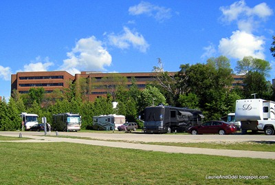 RV's with the hospital on the bluff above the park.