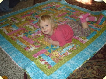 Sammie with her new quilt