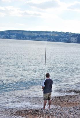 The men sea fishing off Seaton beach.