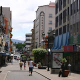Just a trickle of people walk down Avenida Central pedestrian boulevard.