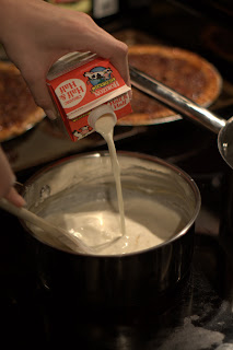 picture of adding half and half to the flour and butter mixture, making a bechamel