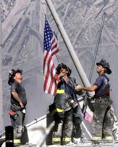 NYC, NY  09/11/01  WTCCRASH  : Firemen raised a flag where WTC was.    -Thomas E. Franklin / The Record - (Bergen County NJ)