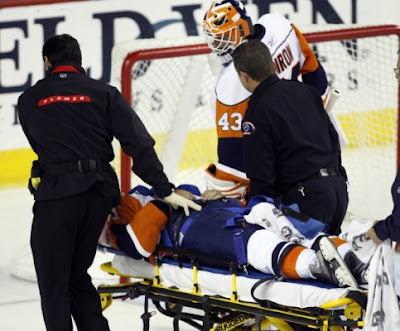 Kyle Okposo is wheeled off the ice on a stretcher after a vicious open-ice hit by Dion Phaneuf.  Photo courtesy of NY Newsday