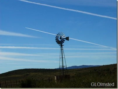 Windmill with contrail behind along Road to Placerita Weaver Moutains Arizona
