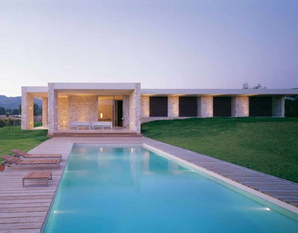 contemporary stone home with swimming pool