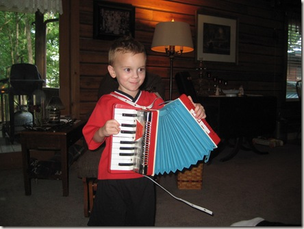 Austin playing the accordion