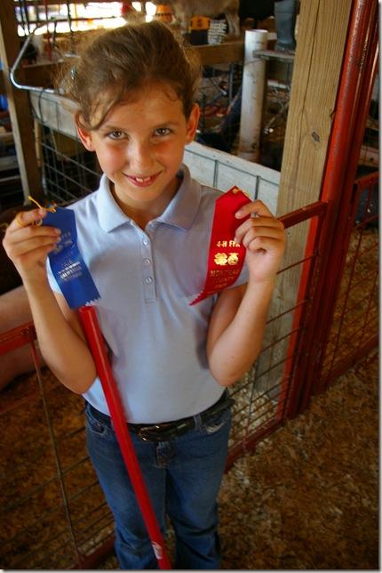 Cara displaying her ribbons
