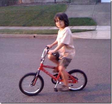 Giant boy on a teensy bike