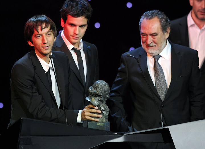 Chilean film director Matias Bize (L) receives the award for Best Spanish Language Foreign Film for 'La vida de los Peces' or 'The Life of Fish' during the Goya Film Awards ceremony at Teatro Real in Madrid on February 13, 2011.  AFP PHOTO / JAVIER SORIANO