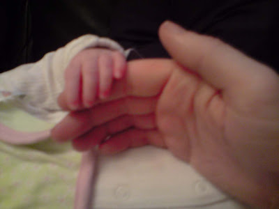 picture of a baby's hands over my first finger. The difference in size is as you'd expect - big man hands and tiny baby fingers.