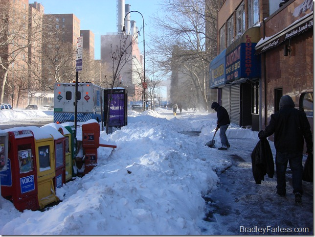 People working to clear the sidewalks.