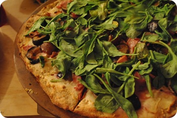 goat cheese, fig, prosciutto, honey, and arugula pizza