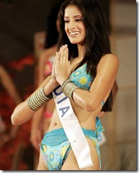 Mihika Varma, 19, greets to journalists during a press preview of the 2004 Miss International Beauty Pageant in Tokyo.