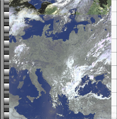 NOAA 19 northbound 57E at 10 Jul 2010 11:25:14 GMT on 137.10MHz, HVCT enhancement, Normal projection, Channel A: 2 (near infrared), Channel B: 4 (thermal infrared)
