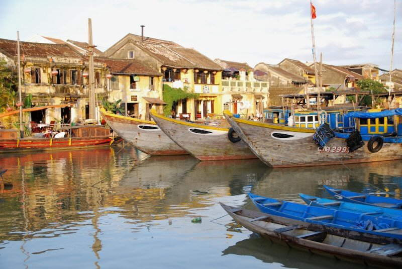 Colors of Vietnam: Skyscrapers, Islands, Boating, Caves, Traditional Markets, Religious Prayers, Flowers, Shopping