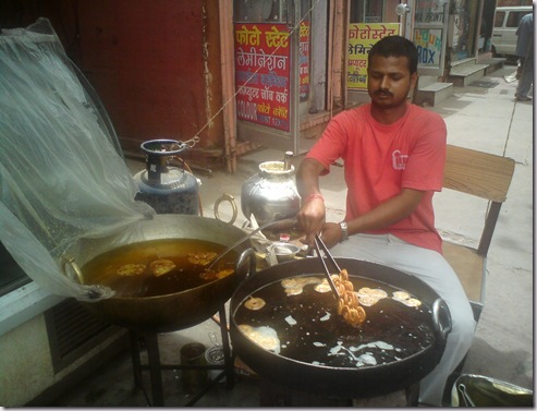 jalebiMaking hot piping sweet Jalebis at Samrat sweet shop, Jaipur