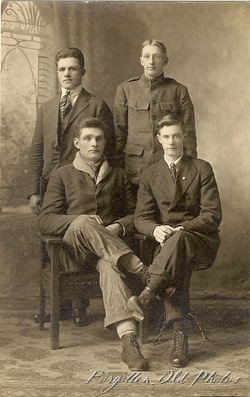 Four Boys one a Soldier Cyko Postcard