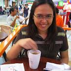 Wifey swirling her coffee at Roti Mum