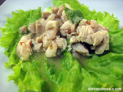 Laarb Gai (minced chicken salad with cilantro on a bed of lettuce)